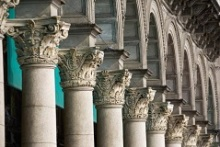 Close Up Of The Tops Of A Row Of Corinthian Columns And Arches