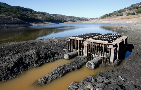 The intake structure at Chesbro Reservoir is totally exposed in Morgan Hill, Calif., on Monday, Nov. 10, 2014. Normally under water, three years of severe drought has dried up the reservoir around it to only one percent of capacity. (Gary Reyes/Bay Area News Group)